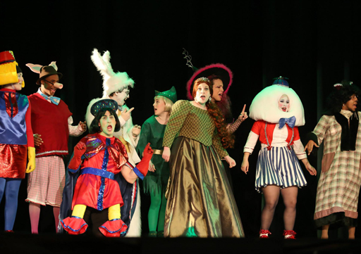 group in costumes singing a song during a theatre performance